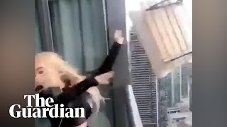 Video of woman throwing chair off 45th storey balcony in Canada