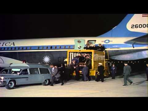 The casket containing John Fitzgerald Kennedy's body is carried to an ambulance f...HD Stock Footage
