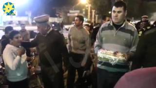 بالفيديو: قيادات مديرية أمن البحيرة توزع حلوى  المولد النبوى على المواطنين