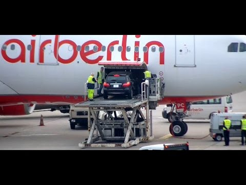 A car is loaded onto an aircraft of type A330 - very hard and complicated - Berlin Tegel