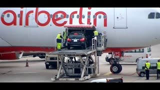 a car is loaded onto an aircraft of type a330 very hard and complicated berlin tegel