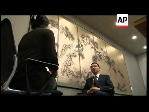 Japanese return to work after quake; analyst on long-term recovery