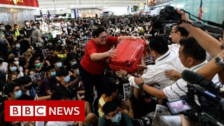 Hong Kong protests disrupt airport for second day - BBC News