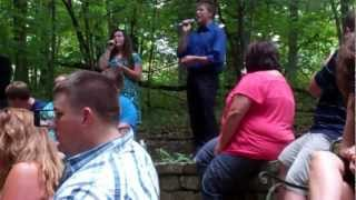 Ashley and Trenton singing at wedding