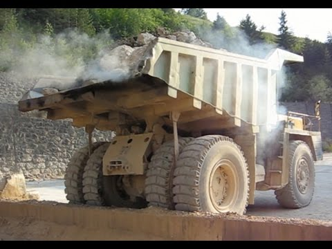 Big trucks carrying stones to the stone crusher plant