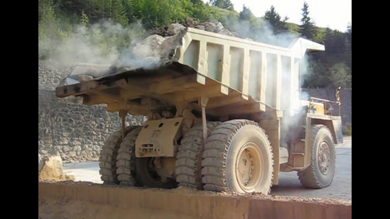 Big Dump Trucks >> Big trucks carrying stones to the stone crusher plant ...