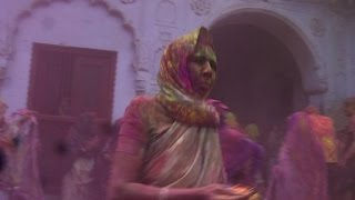 Indian widows and children celebrate Holi in holy town