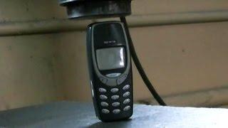 Crushing Nokia 3310 with hydraulic press