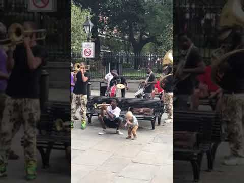 A toddler joined a Jackson Square brass band in the most adorable jam session ever