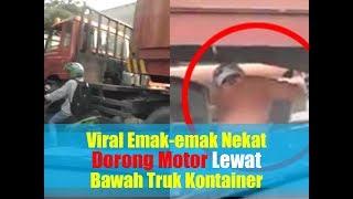 Viral Aksi Emak-emak Nekat Dorong Motor Lewat Bawah Truk Kontainer