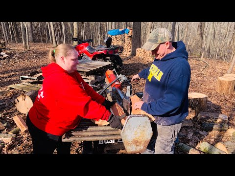 "Firewood log splitting team - husband and wife ""the game players"""