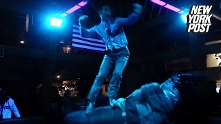 Cowboy Dances on a Mechanical Bull While Looking Dapper as Hell
