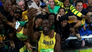 Usain Bolt's girlfriend can't control her delight as she cheers him on to an eighth gold medal