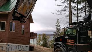 Building Express drywall delivery with boom truck