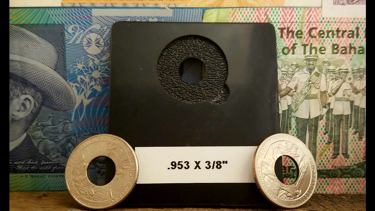 New Tool for a Perfectly Centered Hole in a Coin Ring