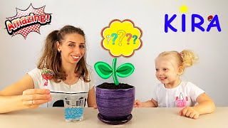 Kira and Mommy plant lollipops's tree / surprise toys /  toy's unboxing