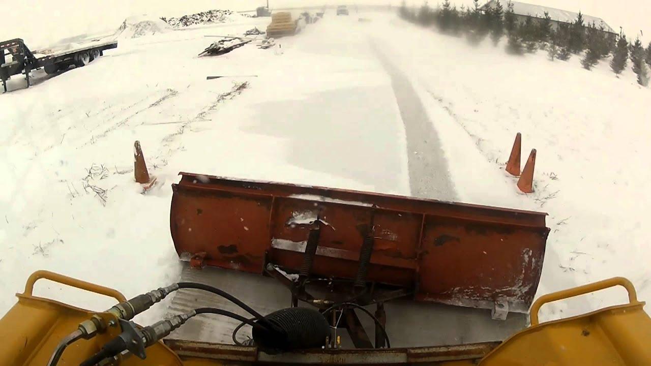 Deere Skid Loader Pushing Snow