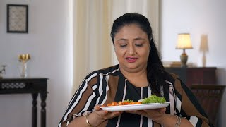 Indian overweight woman with a frowning expression - Humourous dieting concept