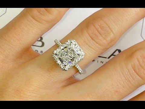 2 carat elongated radiant cut diamond halo engagement ring