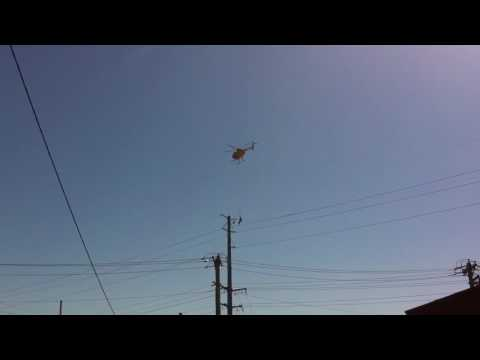 Ameren worker lifted by helicopter to do a high wire repair.