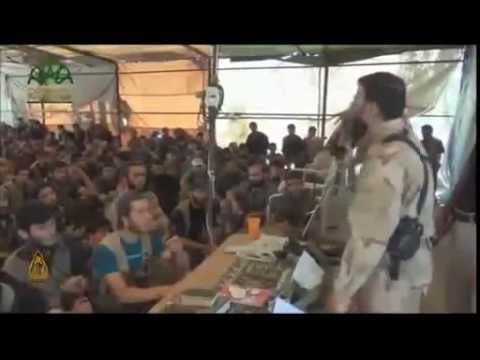 Syrian rebel leader delivers speech with a pink Hello Kitty notebook