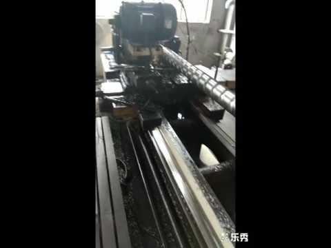 Bimetallic screw barrel for plastic
