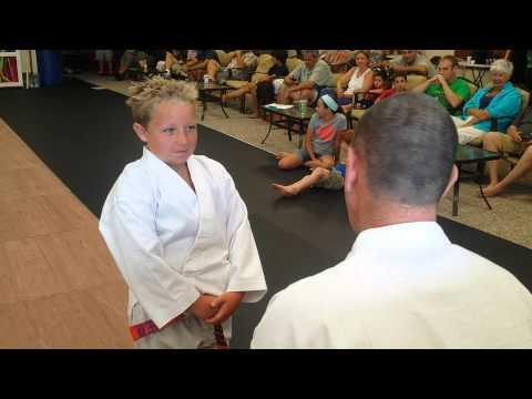 Jackson Nicoll receiving his purple belt!