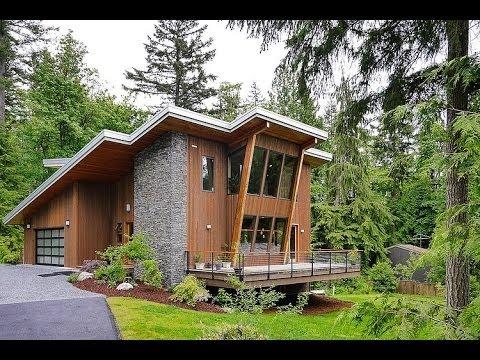 Dise o de casa moderna de dos pisos madera y piedra - Casas prefabricadas de piedra ...