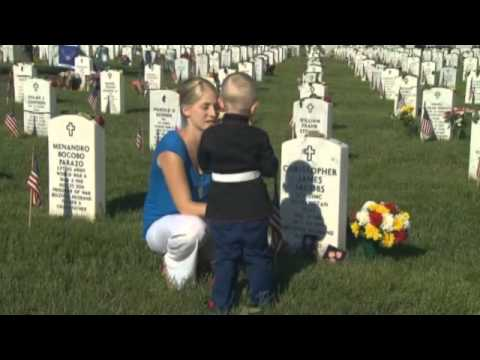Three-Year-Old Visits Father's Grave at Arlington National Cemetery