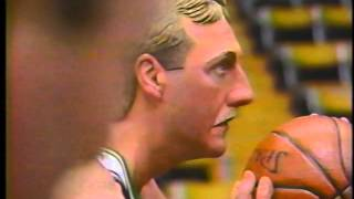 Basketball great, Larry Bird, carved in wood