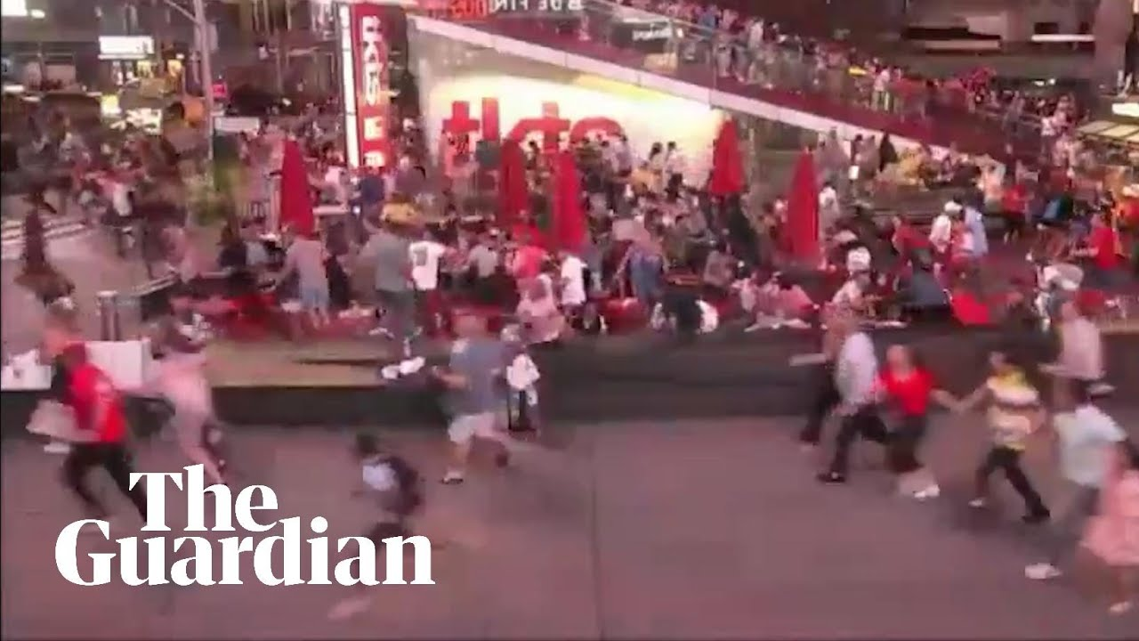 Panic in Times Square after motorcycle backfire mistaken for gunfire – video