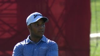 Harold Varner III finishes in style on No. 18 at Quicken Loans