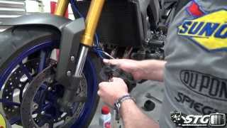 How To Replace Front Brake Pads on a Yamaha FZ-09 from SportbikeTrackGear.com