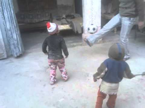 Meerab Abbasi, Arham Abbasi & Ayyan Abbasi playing football at home.