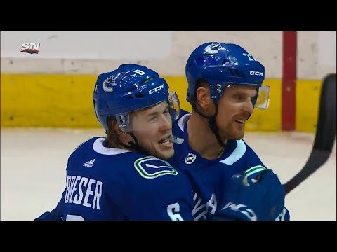 Boeser makes no mistake on second chance after hitting post