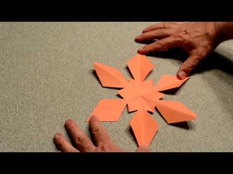How to fold and cut a six-sided paper snowflake