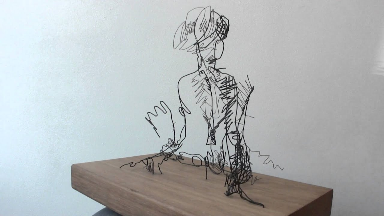 Wire sketch sculpture of a woman. - YouTube
