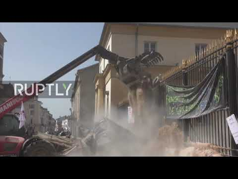 France: Protesting farmers dump earth and hay outside municipal buildings