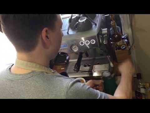 Pouring a Rosetta coffee - Latte art