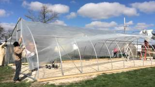 Covering the Greenhouse with Poly