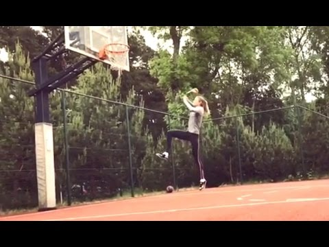 Women high jump champion tries max vertical on basketball rim