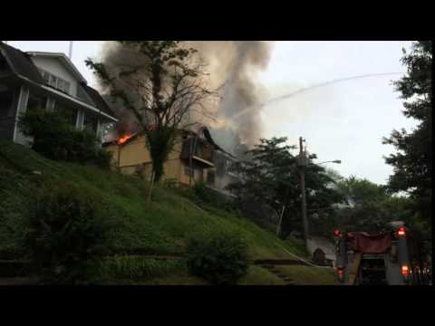 Firefighters rescue man, dog from apartment fire