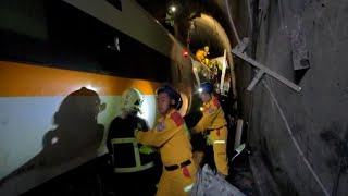 video: Taiwan train crash: at least 51 dead after carriages derail in tunnel