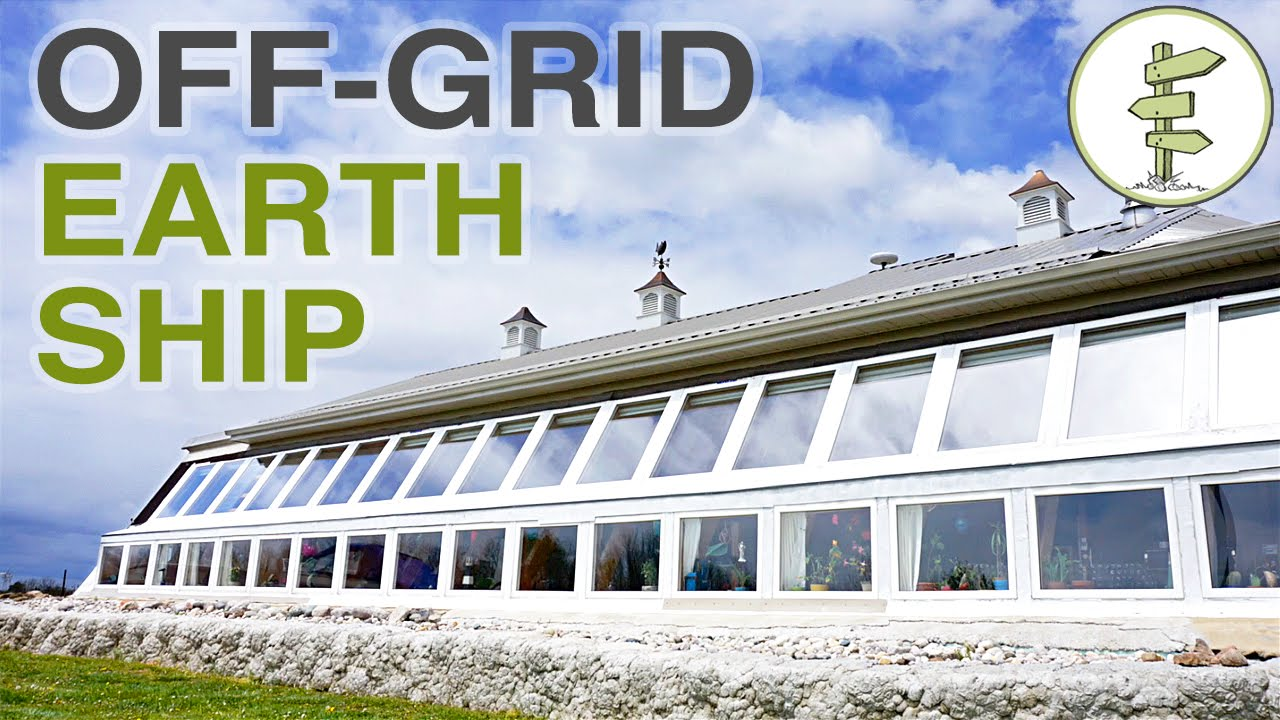 Super efficient off grid earthship built for early for Super efficient house plans