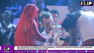 ara unleashes thunderous performance presents african talking drum to pres macron in afrika shrine