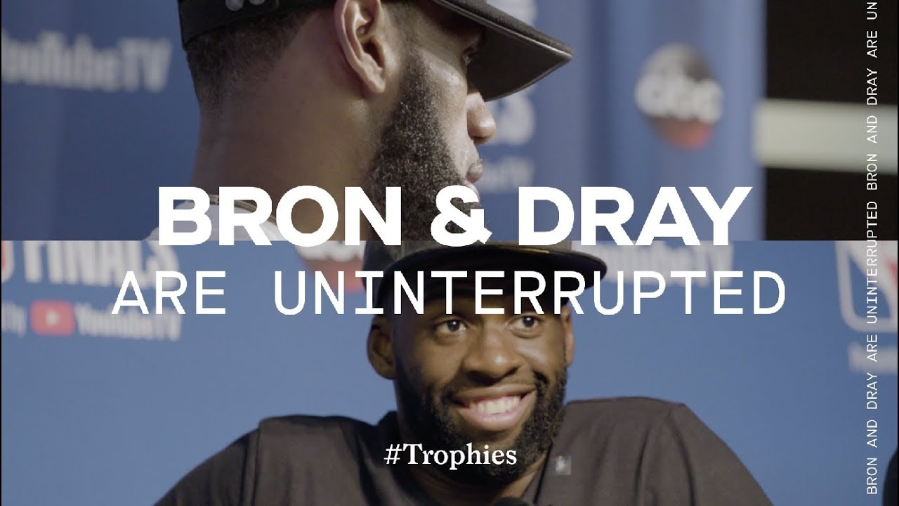 lebron-james-and-draymond-green-face-off-in-nba-finals-trophies
