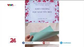 Nhiều học sinh quận Cầu Giấy nhận thưởng 1 tờ giấy | VTV24