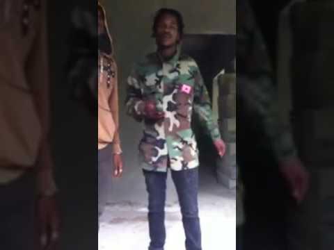 Jamaican Gunmen showing off their illegal weapons