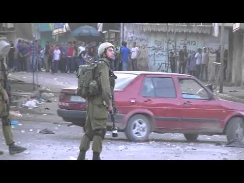 Clashes between Israeli army and Palestinians in Hebron market 27 August 2013