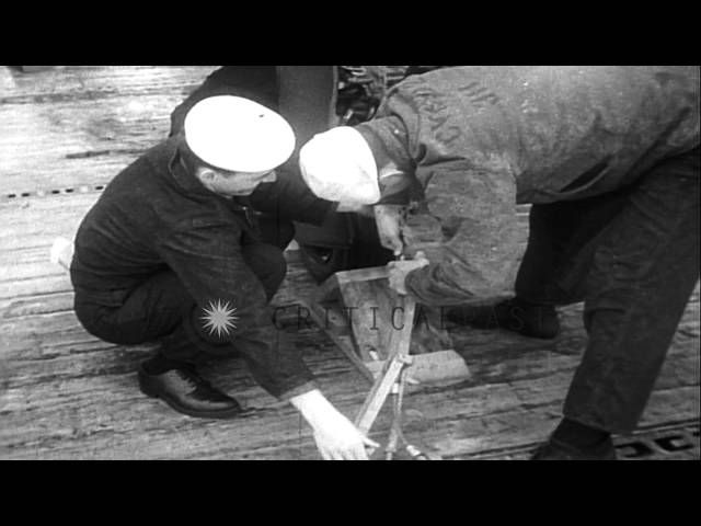 US Navy F8F Bearcat fighters being loaded aboard USS Windham Bay for Indochina Wa...HD Stock Footage